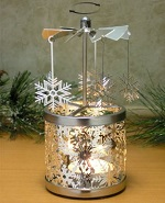 Spinning snowflake candle